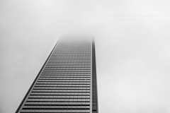 Through the fog (HisPhotographs.com) Tags: toronto ontario canada downtown building fog highrise bw grayscale city cloudy foggy