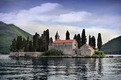 St George Island, Perast (Jocelyn777) Tags: water seascapes landscapes sea churches islands orthodoxchurch trees sky clouds mountains stones stonebuildings stonehouses perast bayofkotor montenegro balkans travel textured
