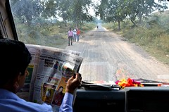 News on the Road (Pedestrian Photographer) Tags: bus dashboard newspaper read reading reader fatehpur sikri india road trees windshield