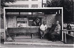 Chiacchiera alla fermata (chats at the bus stop) (Loodoveeca) Tags: calitri campania busstop oldmen countrylife waiting chat slowlife blackandwhite bw blackandwhitefilmphotography biancoenero noiretblanc film filmisnotdead filmisalive filmphotography filmisbetter 35mm 35mmfilm analog analogphotography analogicphotography analogic analogica analogisbetter streetphotography street