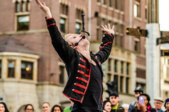 Amsterdam Street Performer (Adri Pendleton Photography) Tags: amsterdam dutch netherlands outdoor act air arms boy carnival caucasian circus city crowd dam danger dangerous eccentric excited fireboy hands happy held historic hold holiday life lifestyle man many mic microphone outside people praise proud risk show square style swallow sword tommy tourism tourist typical up vacation victorious white young