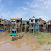 Local Houses on Wooden Stilts in Floating Village in Siem Reap