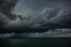 Storm With Heavy Rain (betadecay2000) Tags: meer wasser himmel bucht berg landschaft ozean boot bedeckt wolke