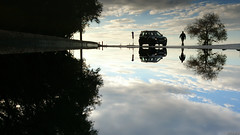 Upside down (KOSTAS PILOT) Tags: greece achaia peloponnese peloponese patras reflection watermirror mirroring puddle water silhouette shadows kostaspilot sony sonyx xperia coast walking sunset sky goldenlight goldenhour clouds winter abstract symmetry symmetricalview car patraikos mediterranean ionion ελλάδα πελοπόννησοσ αχαιασ πατρα πατραικοσ μεσόγειοσ ουρανόσ περπάτημα αυτοκίνητο σιλουέτα σκιεσ ηλιοβασίλεμα χρυσοφωσ χρυσηωρα αντανάκλαση παραλίαπατρων παραλία δρομοσ συννεφα συμμετρία microcosmos δενδρο smartphone upsidedown