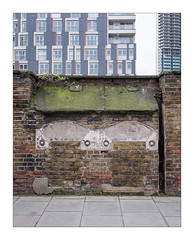 The Built Environment, East London, England. (Joseph O'Malley64) Tags: thebuiltenvironment newtopography newtopographics manmadeenvironment manmadestructures buildings structures urban urbanlandscape architecture architecturalfeatures architecturalphotography britishdocumentaryphotography documentaryphotography eastlondon eastend london england uk britain british greatbritain brickwork bricksmortar cement pointing stonework brickedupwindows buddleia newbuilds towers towerblocks housing homes dwellings abodes highdensityhousing creepinggentrification gentrification pavement fujix fujix100t demolition partiallydemolishedbuilding capstones castirondrainpipe drainpipe airbricks vents accuracyprecision