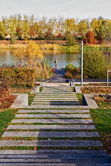 Fishing At The End Of The Stairs (k009034) Tags: 500px water copy space day europe france outdoors serris tranquil scene autumn clouds concrete fall fishing hobby lake leaves man nature park people shadows sky stairs travel trees teamcanon copyspace tranquilscene