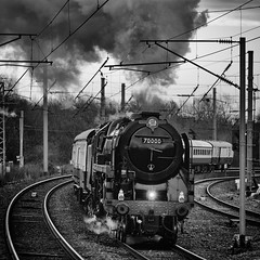 Britannia steams through Wigan NW (Mister Oy) Tags: mono monochrome blackandwhite steam train locomotive 70000 britannia railtour wigan wigannorthwestern fujixpro2 fuji50140mmf28 heritage 1960s britishrailways railway