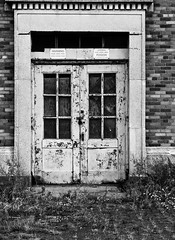 No Solicitors (EssGee Photography™) Tags: floydbennettfield lumixlf1 newyork travel tourist gatewaynationalrecreationarea doorway door digital decay building brooklyn brick blackwhite blackandwhite artdeco architecture abandoned bw