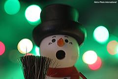 Snowman (Retro Photo International) Tags: snowman bokeh leds macro macromondays holidaybokeh carlzeissjena tessar 50mm 35 winter