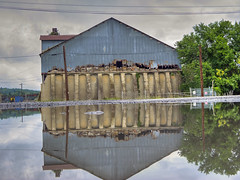 Waterfront Property (milfodd) Tags: july 2018 puddle reflection singlerawhdr warehouse decay