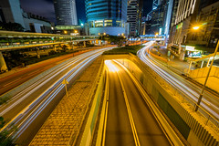 Traffic at central district in Hong Kong at dusk time. Car light trails and urban landscape in Hong Kong . (MongkolChuewong) Tags: architecture asia background blue blur building business car center central china city cityscape district downtown evening fast financial high highway hong hongkong kong landmark landscape life light metropolitan modern motion night office popular population road sky skyline skyscraper speed street sunset tower town traffic trail trails transport transportation urban way