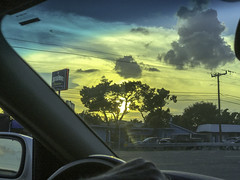 Driving in a Sarasota Sunset (soniaadammurray - On & Off) Tags: iphone driving sunset car sky clouds trees road nature exterior artchallenge quartasunset