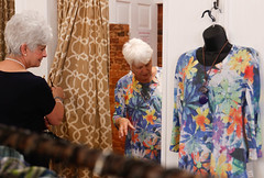 Merchant helps Lucy Fambrough, 82, retired, from Watkinsville, Georgia, pick out an outfit. The outfit happens to be the same one that is on the mannequin outside of her dressing room.