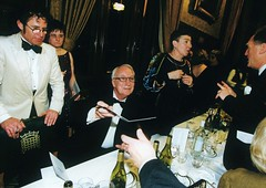 Chairman Philip Porter looks on as Ian Richardson signs an admirer's menu (photo by Tony Marshall)