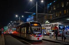 Edinburgh tram (Rourkeor) Tags: 35mm 35mmzeisssonnartlens carlzeiss edinburgh princesstreet rx1r scotland sony uk buses colourful fullframe lightshadows pedestrians people reflections street taxi tram