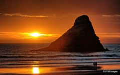 Heceta Beach Sunset (pandt) Tags: heceta beach oregon sunset couple romantic orange yellow waves sand coast coastal silhouette clouds sky amber people seastack outdoor waterscape landscape nature flickr reflection canon eos slr rebel t1i color colors colorful