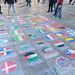Malereien aus Kreide auf dem Boden einer Fussgängerzone  - Länderflaggen