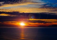 Sundown (stewartbaird) Tags: sun summer newzealand sunset nature sky southisland flare landscape sea