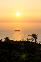 Hazy Sunset and Cargo Ship (do_japan) Tags: taiwan kaohsiung asia cargo ship boat sea ocean water sunset evening transport freight wave sky cloud haze pollution smog smoke tree forest jungle