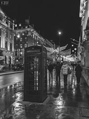 London Calling (CJD imagery) Tags: people blackandwhite blackwhite monochrome canonefs18135mmf3556isstm canoneos80d telephonebox nightphotography streetphotography city christmaslights festive london regentstreet england gb greatbritain uk unitedkingdom