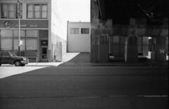 view across street (ThroopD) Tags: rollei400s filmchemistry chemistryartifact onewaystreet monochrome unmonochromy