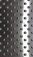 A metal drain cover (stephenbrown390) Tags: drain metal lightanddark shadow