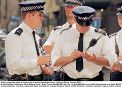 """Police Group 3 (hoffman) Tags: constable group handcuff horizontal notebook outdoors police radio sergeant street uniform water writing davidhoffman wwwhoffmanphotoscom london uk davidhoffmanphotolibrary socialissues reportage stockphotos""""stock photostock photography"""" stockphotographs""""documentarywwwhoffmanphotoscom copyright"""