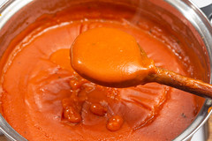 Fresh domestic homemade tomato sauce on the wooden scoop (wuestenigel) Tags: spice natural dressing dieting dish spiced background red homemade cooked isolatedonwhite isolated white vegetable tomato closeup cooking focus ketchup healthy nobody tasty nutrition lunch food sauce spicy gourmet cuisine dining freshness health iconic fresh meal ingredient bowl