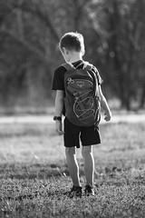 Edric hiking (scottryantucker) Tags: hiking field pack kid son boy black white