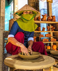 Potter in Thanh Ha (cheryl strahl) Tags: vietnam northernvietnam danang hoian village potter pottery craft thubonriver tourist clay wheel asia