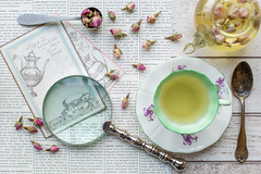 342/365: A cup of tea warms the soul like a good friend [Explored] (judi may) Tags: 365the2018edition 3652018 day342365 08dec18 flatlay stilllife teacup tea teapot rosebuds rosebudtea magnifyingglass spoon vintage vintagestyle postcards tabletopphotography glass canon5d 50mm