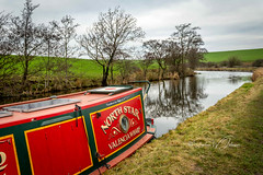 SJ1_4372 - The North Star (SWJuk) Tags: skipton england unitedkingdom swjuk uk gb britain english yorkshire northyorkshire canal leedsliverpoolcanal boat narrowboat barge thenorthstar towpath moored grass trees red water flat calm reflections clouds greysky fields farmland 2019 jan2019 winter landscape waterscape countryside scenery nikon d7200 nikond7200 nikkor1755mmf28 rawnef lightroomclassiccc