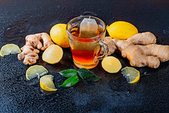 A cup of hot tea with lemon and fresh ginger root (wuestenigel) Tags: spice glass ginger cup herb citrus fruit raw medicine drink beverage herbal kitchen background tea hot tasty lemon plant nutrition root spicy leaflets natural sweet ingredient health green fresh yellow healthy organic food lebensmittel zitrone desktop noperson keineperson gesund obst glas stilllife stillleben getränk vegetable gemüse süss leaf blatt refreshment erfrischung heis color farbe table tabelle cooking kochen closeup nahansicht wood holz diet diät