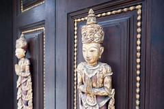 Door carvings (SLpixeLS) Tags: thailand dara devi hotel chiangmai statue door carving sculpture