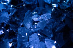 Small lights among large pieces of ice (AlexMadWorld) Tags: lights ice chunks cold water winter light small blue beautiful dark bright abstraction time year frost frozen