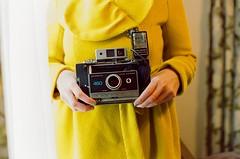 Land Camera (Kenneth John Taylor) Tags: windowlight fashion yellow naturallight portrait polaroid camera film cinestill