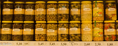 Spain-13 (pa0mjm) Tags: nikond7000 málaga marketplace lychees onions pots shelf beans prices market spain repetition food glas