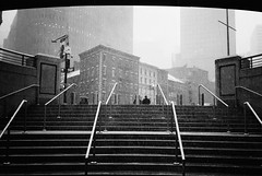 I emerge into the elements, burrito in hand (ekonon) Tags: stairs 1 monochrome lowermanhattan manhattan financialdistrict weather snow olympusxa2 pushedonestop blackandwhite film filmphotography