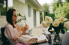 (Džesika Devic) Tags: rose leicam6 portrait girl book backyard california palmdesert desert kodak kodakgold200 documentary film 35mm roses