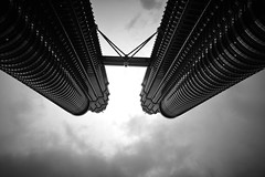 To Boldly Go Where No Man Has Gone Before... (RobˍLee) Tags: petronas twin towers monochrome noireblanc sky cloudy overcast season abstract rainy building architecture spaceship space monsoon lines curves light shadows geometry adventure exploration scifi science fiction startrek
