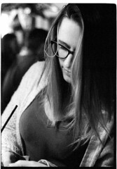 F2sbDeltaDevonTacoDaddy_010 (Johnny Martyr) Tags: girl glasses woman eyeglasses spectacles lens hair thinking thoughtful studying contemplating bw black white film 35mm grain grainy ilford delta 3200 6400 iso nikon nikkor f2sb 50mm 14 sc portrait candid unawares documentary photojournalism close up personal intimate delicate moment she her dark night darkness nightime