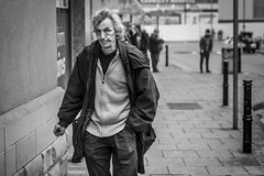 Deep Pockets (Leanne Boulton) Tags: urban street candid portrait portraiture streetphotography candidstreetphotography candidportrait streetportrait eyecontact candideyecontact streetlife man male face eyes expression mood feeling emotion smoke smoker smoking cigarette wrinkles weather worn tone texture detail depthoffield bokeh naturallight outdoor light shade city scene human life living humanity society culture lifestyle people canon canon5dmkiii 70mm ef2470mmf28liiusm black white blackwhite bw mono blackandwhite monochrome barnsley england uk
