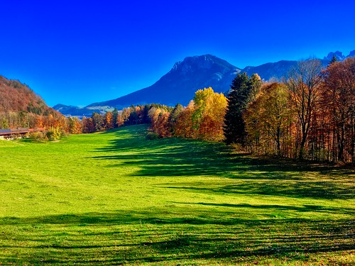 Autumn landscape with view towards Kaiser mountains in Breitenau near Kiefersfelden, Bavaria, Germany
