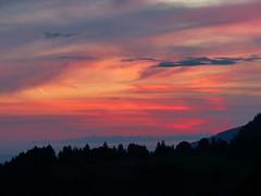 Fiery Sky (Marit Buelens) Tags: sky clouds colours paintthesky suisse schweiz switzerland schwyz muotathal illgau oberefraumatt forest mountain sonnenuntergang zonsondergang couchedesoleil sunset