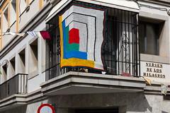 Milagros Square (Bruce Poole) Tags: brucepoole elpuertodesantamaria october2018 andalucia andalusia brucesspace spain crochet streetart squares yellowbluegreenred balcony corner crochetcorner puerto