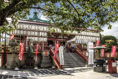 Shinobazunoike Bentendo Temple, Ueno - Tokyo (Japan) (Andrea Moscato) Tags: andreamoscato giappone japan nippon nihon 日本 sollevante view vivid light shadow ombre street strada tokyo 東京 japanese giapponese capitale capital prefecture prefettura district architecture architettura pedestrian ward quartiere ombra attraction luce day art artist red wood perspective orange walk walkway trees alberi sun sunshine paesaggio parco park people pietra persone via viale branch terra entrance stones sculpture nature natura taitō stair lanterna white flag tempio
