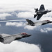 Three F-35C Lightning II aircraft complete a flight over Eglin Air Force Base.