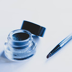 Gel eyeliner container with brush beside it thumbnail