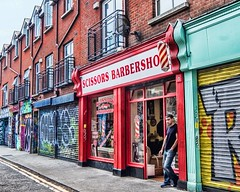 at the barbershop (-liyen-) Tags: dublin barbershop candid street urban graffiti alley streetphotography ireland summer travelphotography fujixt2 challengeyouwinner cyunanimous