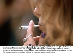 Woman Smokes Joint CU (hoffman) Tags: cannabis crime decriminalise demonstration drugs female hashish horizontal illegality joint lady march marijuana rally smokes smoking woman 181112patchingsetforimagerights london uk